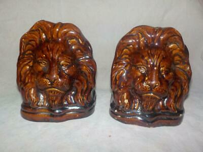 A Pair Of Antique Treacle Glazed Pottery Lion Head Sash Window Props