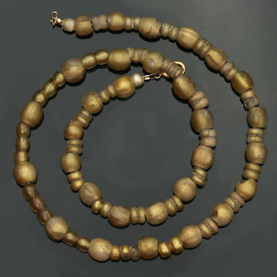 Ancient glass beads: ancient Roman gold glass necklace, 1 century BCE