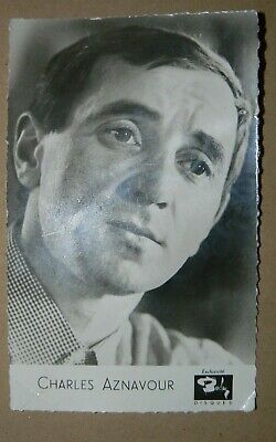 CHARLES AZNAVOUR AUTOGRAPH  HAND SIGNED ON VERSO  14cms x 9cms