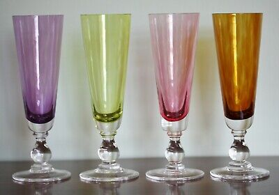 Four Nina Campbell champagne flutes hand made in coloured glass