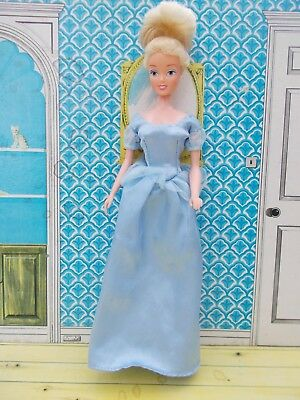 Pretty Disney Cinderella doll with nice hair and original dress
