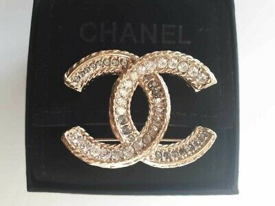 474eabcad192 Authentic CHANEL CC Brooch With Swarovski Crystals in Gold color