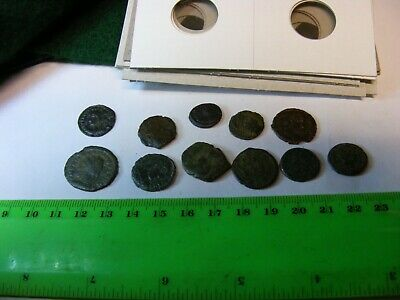 Lot of 11 Ancient Roman Coins,with 2x2 Coin Holders,for resale about $250.00.