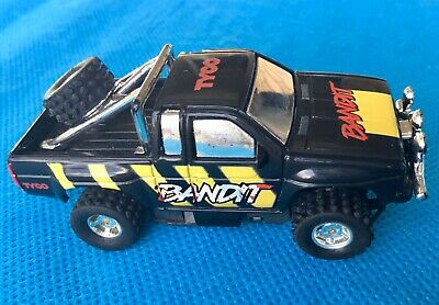 Tyco, Bandit yellow decals, AFX scale slot car, 4x4 set car 1:64th scale.