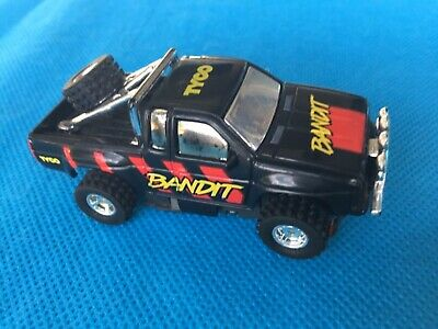 Tyco, Bandit red decals, AFX scale slot car, 4x4 set car 1:64th scale.