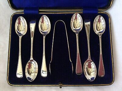 CASED SET OF SOLID SILVER TEASPOONS & TONGS - Barker Brothers, Chester, 1915.