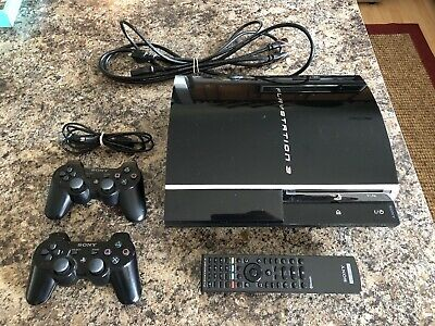 Sony PlayStation 3 PS3 Piano Black 60GB Console (CECH-A01) with Games and Remote