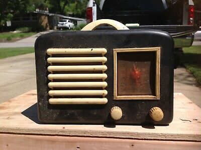 General television and radio Corp Vintage radio. Black case white speaker grill