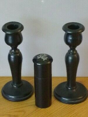 A pair of genuine ebony candlesticks and hair pin cylinder .