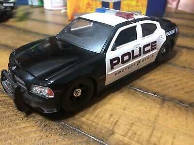 2006 DODGE CHARGER R//T POLICE 1:24 W//STOCK RIMS DIECAST MODEL CAR BY JADA 91984