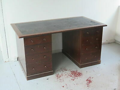 Antique Victorian hardwood pedestal desk with leather writing surface.