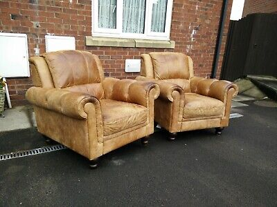 Stunning Vintage Pair of distressed Tan Leather armchairs chesterfield style