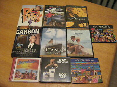 Large lot of assorted DVDs and CDs very large lot must see!!
