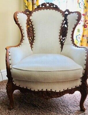 Pair of Vintage Wing Chairs, 1 Carved Lovebirds & Angels 1 Music &  Faces motif