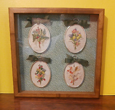 """Four Oval Crewel Pieces Framed in a Wooden Shadow Box 13"""" square"""