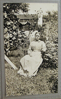 Cabinet Photo Outdoor Portrait Woman Sitting In Her Garden Nursing A Sore Foot