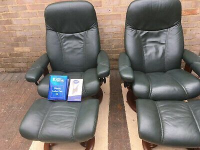 Pair of StressLess leather Recliner Chairs and footstools in Hunter Green colour