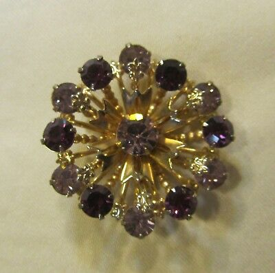 Vintage gold tone flower brooch with purple and white rhinestones