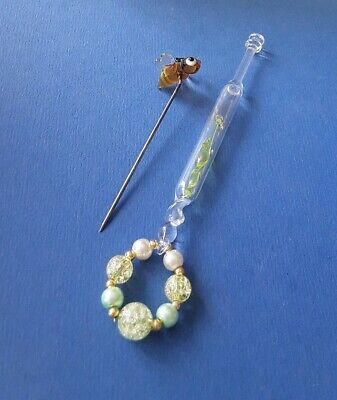 Clear Glass Lace Bobbin with Yellow Babe Inside. A Bee Pricker. Spangles.