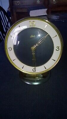 STYLISH VINTAGE `SCHATZ` 8 DAY CLOCK. STANDING ON BASE APPROX.7 ins.TALL FOREIGN