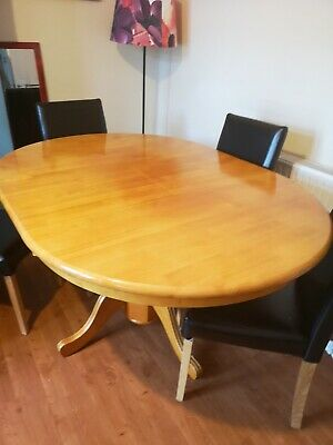 Antique Pine coloured extending dining table