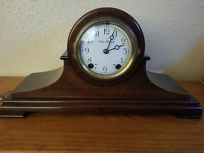 Vintage New haven  mid sized mantle clock, porcelain face , beautiful wood case