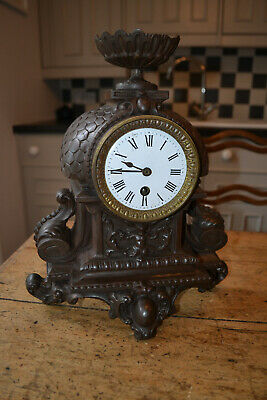 8 day french clock in very decorative cast iron case