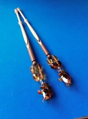 2 Wood Spliced Lace Bobbins with Squirrels on Spangles.