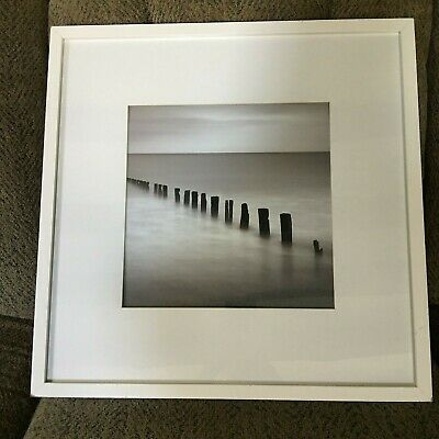 Framed Black & White Photograph of Sea Side old Dock Posts in The Water