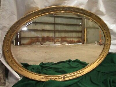 Early 19th century oval gilt framed bevel edged mirror (ref 688)