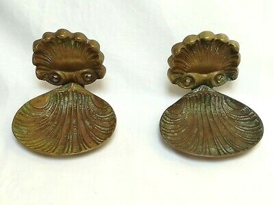 A pair of French Art Nouveau copper/brass scalloped soap holders
