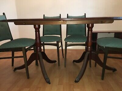 Solid Mahogany Dining Table (162cm extends to 216cm) and 6 chairs. Seats up to 8