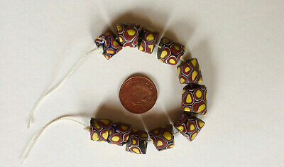 African trade beads, Venetian millefiori, 11 beads on string.