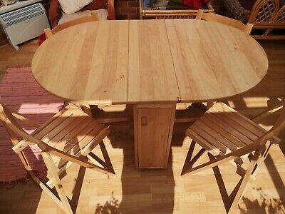 Drop Leaf Dining Table with four folding chairs
