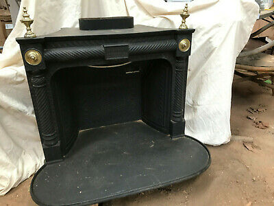 vintage cast iron fire place with brass fittings