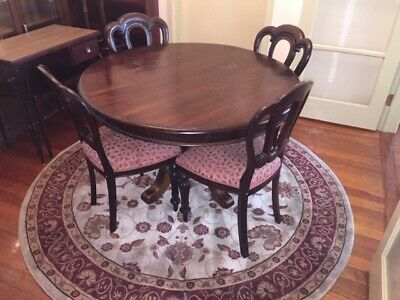 Antique dining table and chairs and round rug