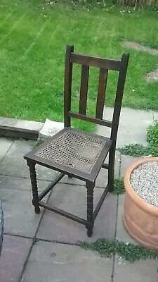 Solid Wood Antique Chair with Turned front Legs. Damage to Cane Seat