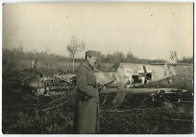 Wwii Photo: Shot Down Luftwaffe Bf 109 Aircraft Watched Over Russian Soldier