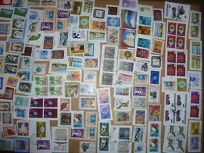 40 grams mixtures United Nations - Swiss stamps on single paper kiloware