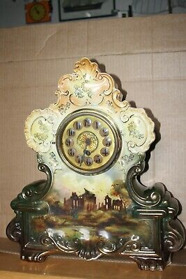 large victorian mantle clock  porcelain case. working with key.
