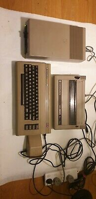 commodore 64 computer with printer and compact disc drive. all work.