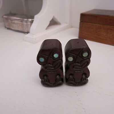 Pair of carved tiki salt & pepper shakers papua shell eyes Rotorua New Zealand