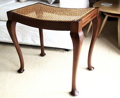 A Vintage Mahogany and Cane Seated Piano/Foot Stool in beautiful condition.