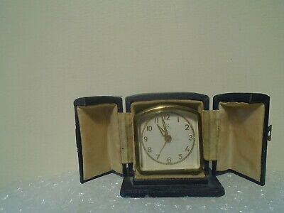Lovely small vintage/antique H.A.C travelling alarm clock & original case  LOOK