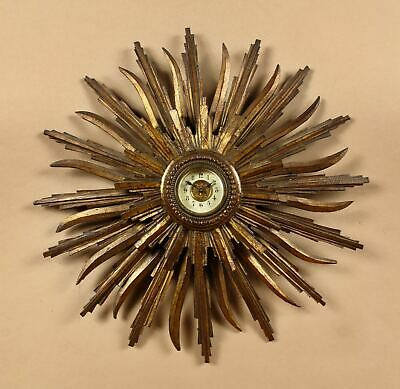 A Carved Wooden And original Gilded Sunburst Wall Clock, French circa: 1900