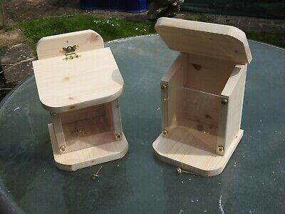 Bespoke squirrel feeder with opening lid for wild garden squirrels to feed .