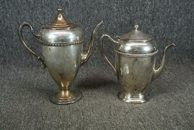 "Set Of Two Silver Plated Pitchers With Lids 8.5"" & 10.5"" Tall F.B. Rogers"