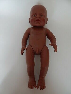 Dolls World Early Moments anatomically correct baby boy ethnic doll - Peterkin