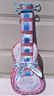 Girls Guitar Diaper Cake-This is an adorable pink and white cake.