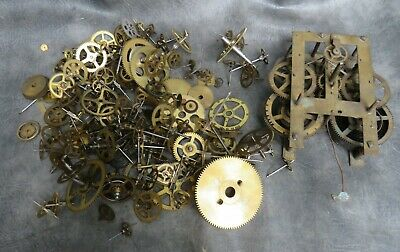 A Large Selection Of Clock Cogs And An American Wall Clock Movement